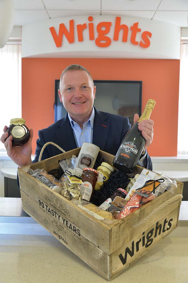 Wrights-Chairman-and-CEO-Peter-Wright-with-one-of-the-90-Tasty-Years-hampers.[7]